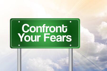 subdue: Confront Your Fears Green Road Sign, business concept Stock Photo