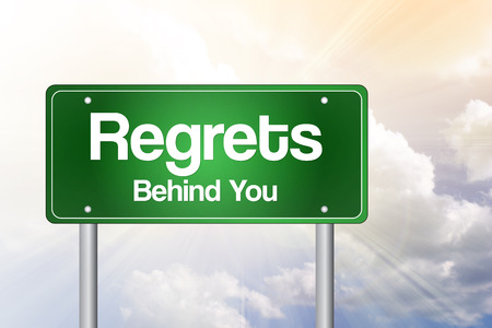 Regrets, Behind You Green Road Sign, business concept Stock Photo