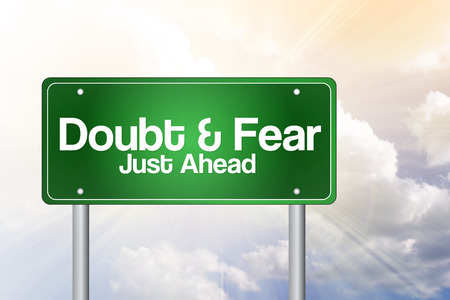doubtfulness: Doubt and Fear Just Ahead Green Road Sign Business Concept