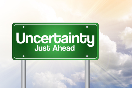 uncertainty: Uncertainty Just Ahead Green Road Sign, business concept
