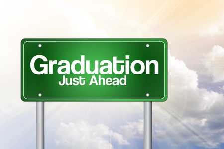 just ahead: Graduation Just Ahead Green Road Sign, education concept Stock Photo