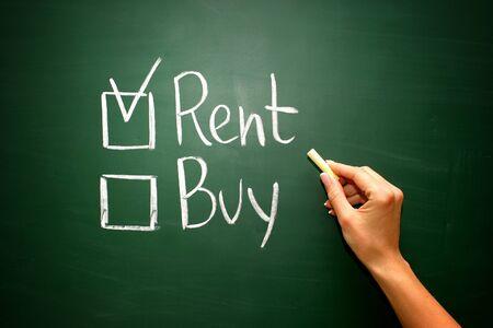 renter: Buy not rent concept on green blackboard