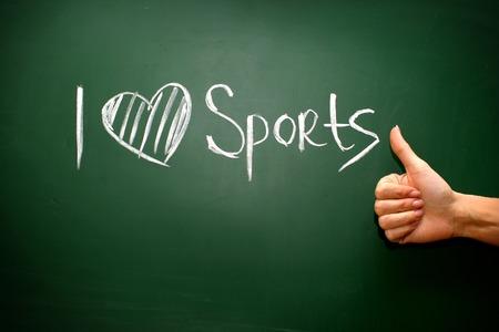 I love sport phrase handwritten on the school blackboard photo