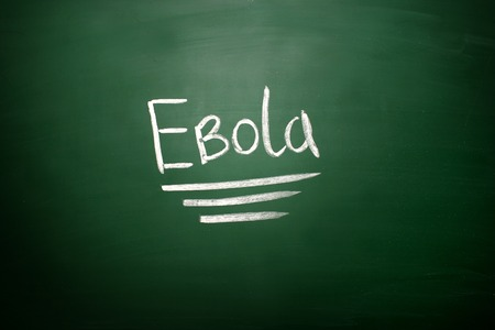 ebola: Ebola virus text on blackboard. EBOLA written on chalkboard. Education concept.