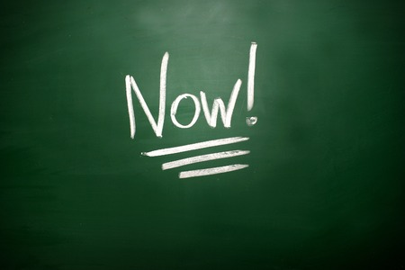 take time out: The word Now! on blackboard. A time management concept