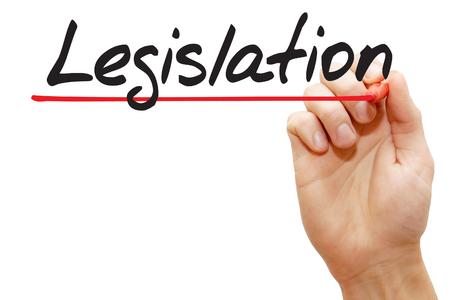 legislating: Hand writing Legislation with red marker, business concept Stock Photo
