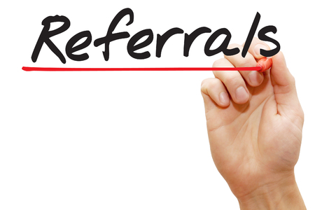 Hand writing Referrals with red marker, business concept photo