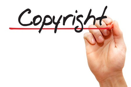 ownership and control: Hand writing Copyright with red marker, business concept Stock Photo