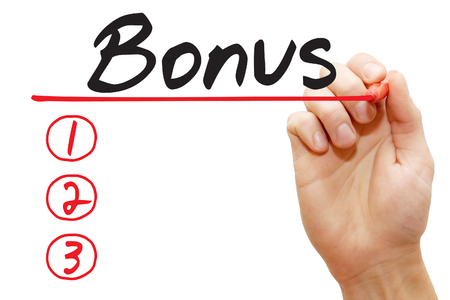 additional compensation: Hand writing Bonus List with red marker, business concept