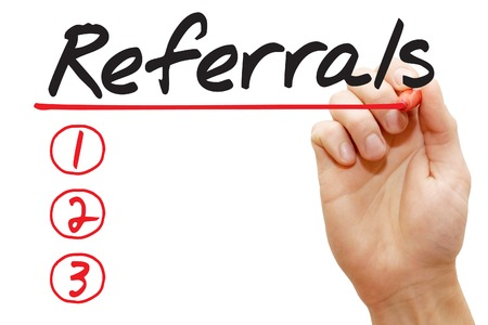 affiliation: Hand writing Referrals List with red marker, business concept