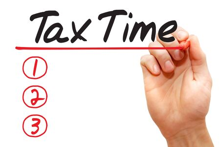 charged: Hand writing Tax Time List with red marker, business concept