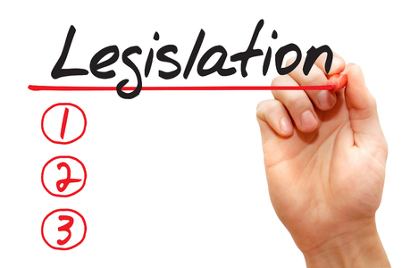 rightfulness: Hand writing Legislation List with red marker, business concept