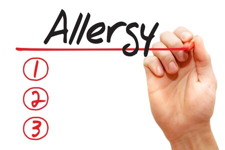 hypersensitivity: Hand writing Allergy List with red marker concept Stock Photo