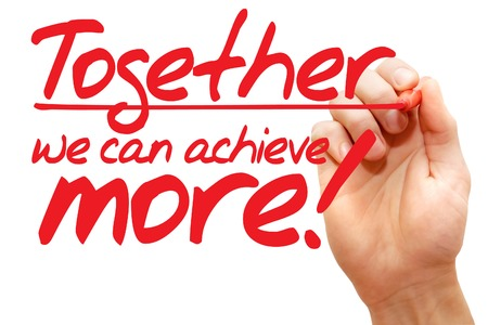 Hand writing Together we can achieve more with red marker, business concept Foto de archivo