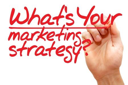 estrategia: Escritura de la mano �Cu�l es su estrategia de marketing con marcador rojo, concepto de negocio Foto de archivo