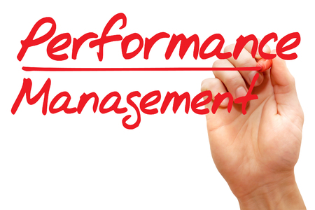 documented: Hand writing Performance Management with red marker, business concept
