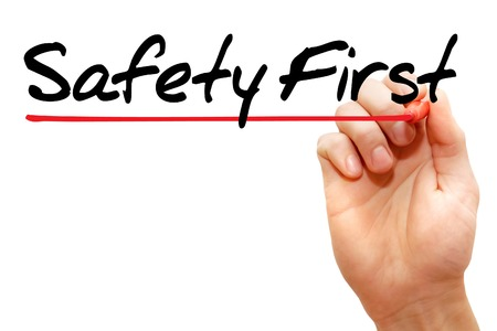 cautionary: Hand writing Safety First with marker, business concept
