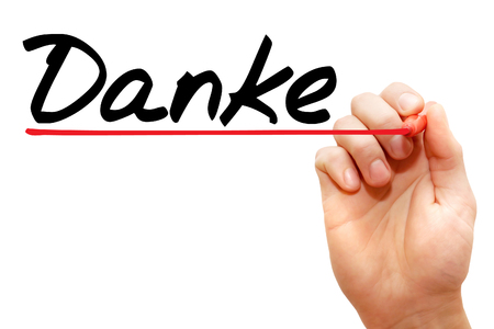 thankfulness: Hand writing Danke with marker, business concept