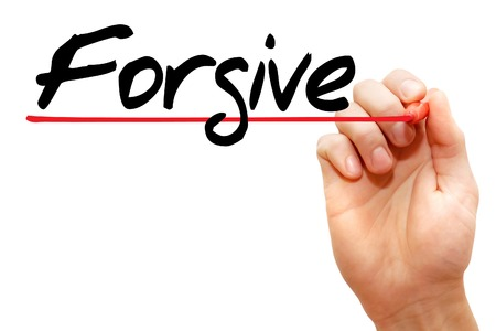 regretful: Hand writing Forgive with marker, business concept