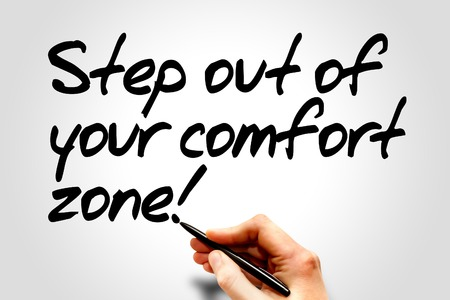 Hand writing Step out of your comfort zone!, business concept Stock Photo