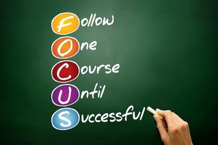 focus: FOCUS, business concept acronym on blackboard