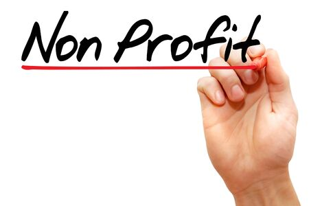 non profit: Hand writing Non Profit with marker, business concept Stock Photo