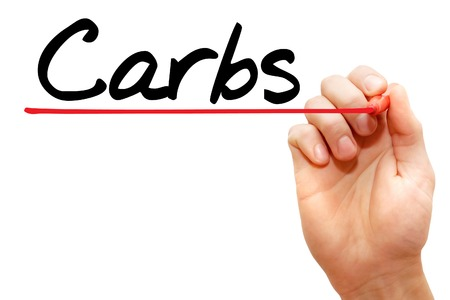 carbs: Hand writing Carbs with marker, health concept Stock Photo