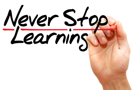 Hand writing Never Stop Learning with marker, business concept photo