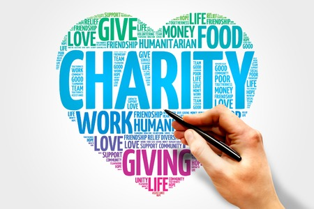 giving money: Charity word cloud heart concept