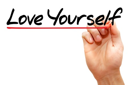 egoistic: Hand writing Love Yourself with marker, business concept Stock Photo