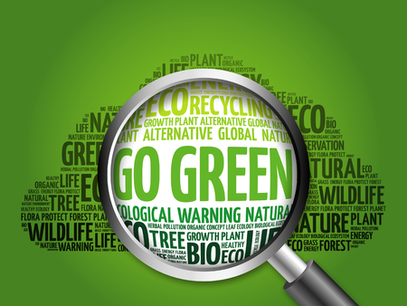 Go Green word cloud with magnifying glass, ecology concept Archivio Fotografico