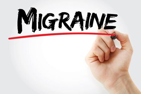 megrim: Hand writing Migraine with marker, health concept Stock Photo