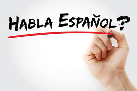 Hand writing Habla Espanol? with marker, business concept