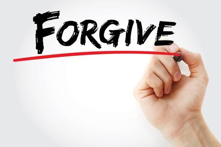perdonar: Escritura de la mano con marcador Perdona, concepto de negocio Foto de archivo