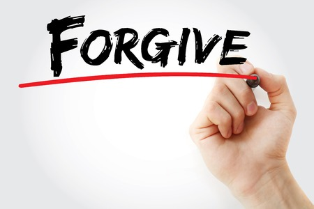 deliverance: Hand writing Forgive with marker, business concept