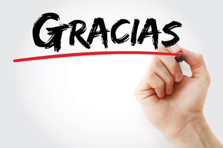 agradecimiento: Escritura de la mano de Gracias (gracias en español) con el marcador, concepto de negocio Foto de archivo