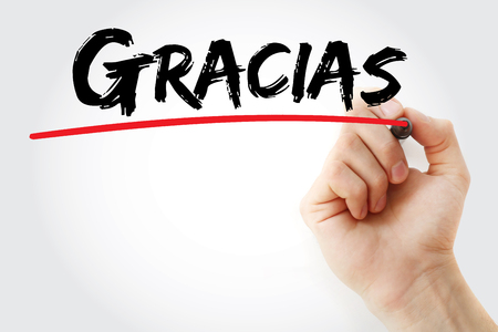 Hand writing Gracias (thank you in spanish) with marker, business concept