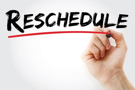 interruption: Hand writing Reschedule with marker, business concept background Stock Photo
