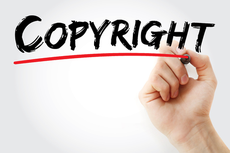 authorship: Hand writing Copyright with red marker, business concept Stock Photo