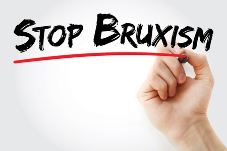 Hand writing Stop Bruxism with marker, health concept background