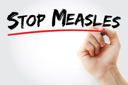 measles: Hand writing Stop Measles with marker, health concept background