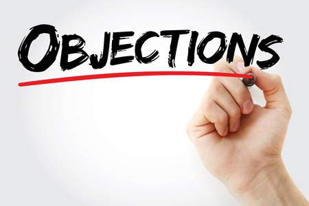 objections: Hand writing Objections with marker, business concept background