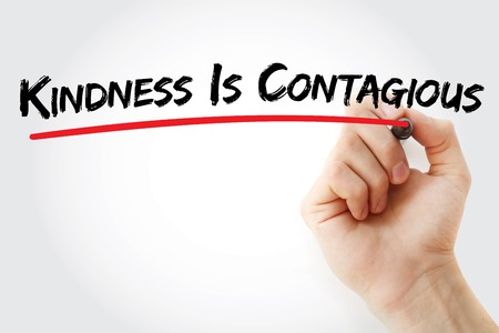 contagious: Hand writing Kindness Is Contagious with marker, health concept background Stock Photo