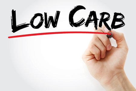 carb: Hand writing Low Carb with marker, health concept background Stock Photo