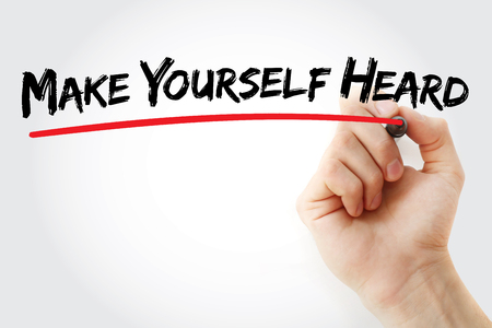 heard: Hand writing Make Yourself Heard with marker, business concept background Stock Photo