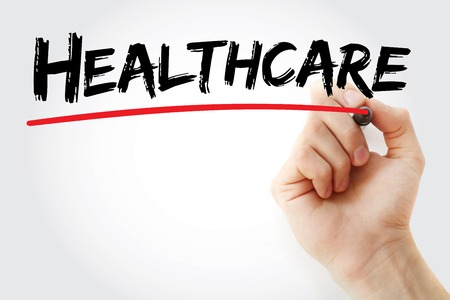 mandated: Hand writing Healthcare with marker, health concept background