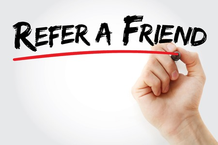 Hand writing Refer a Friend with marker, business concept background