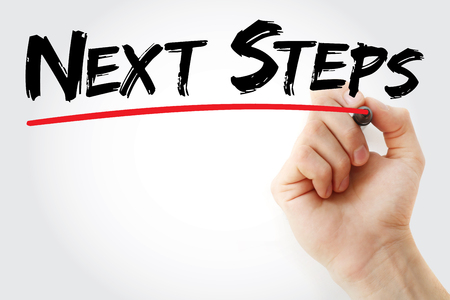 Hand writing Next Steps with marker, health concept background