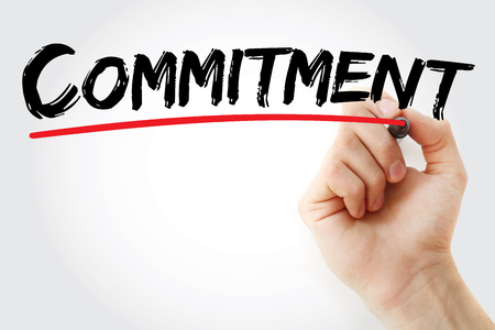 obligate: Hand writing Commitment with marker, business concept background Stock Photo