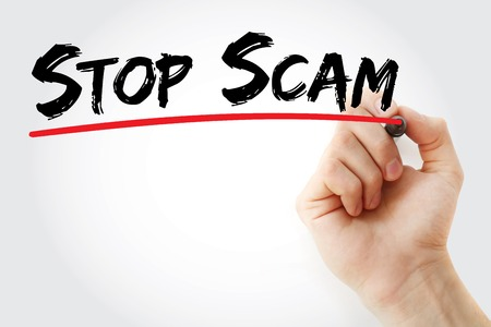 scamming: Hand writing Stop Scam with marker, concept background Stock Photo